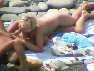 Oral sex on the beach with blonde