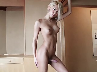 Hot blonde Asian tranny relaxes naked in a hot tub