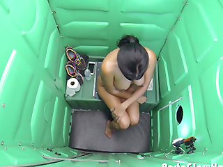 Milf swallows strangers cum in public porta potty gloryhole