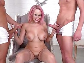 Busty milf spins dicks in both her warm holes