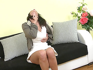 Solo brunette girl Charis fingers her pussy while she moans