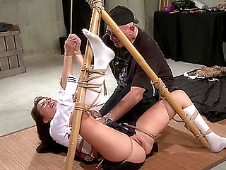 Asian MILF babe tied up with legs behind her head and abused