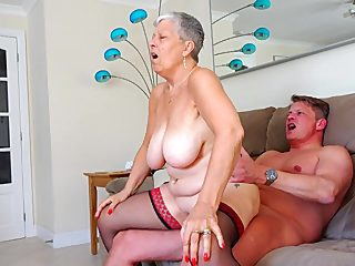 Saggy boobs granny climbs on the dick and rides
