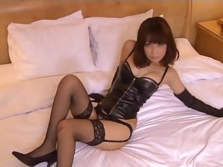 Kinky leather gloves and corset on an Asian babe