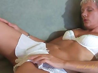 Hot granny plays with her naughty cunt on the couch